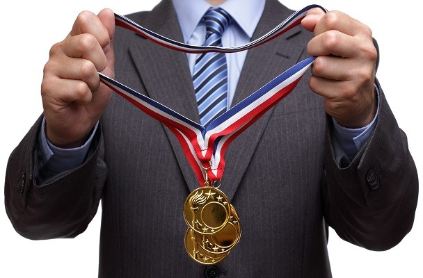 businessman with gold medals