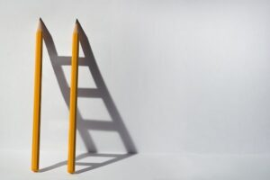 Pencils with Ladder Shadow Demonstrating How Your Job Benefits from Imagination Storytelling Concept